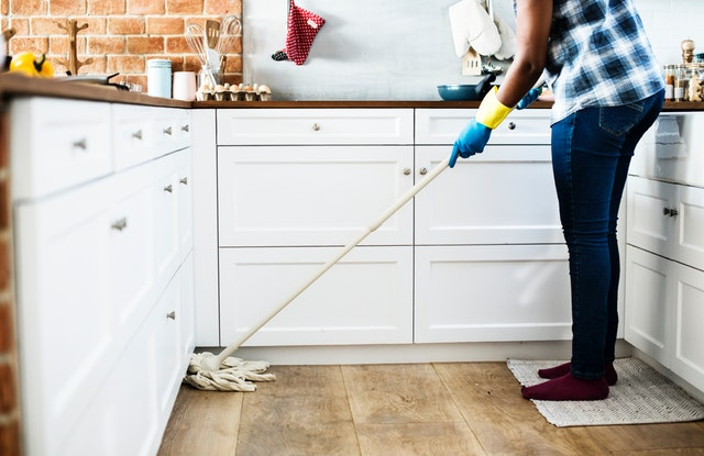 domestic floor cleaning woman in kitchen