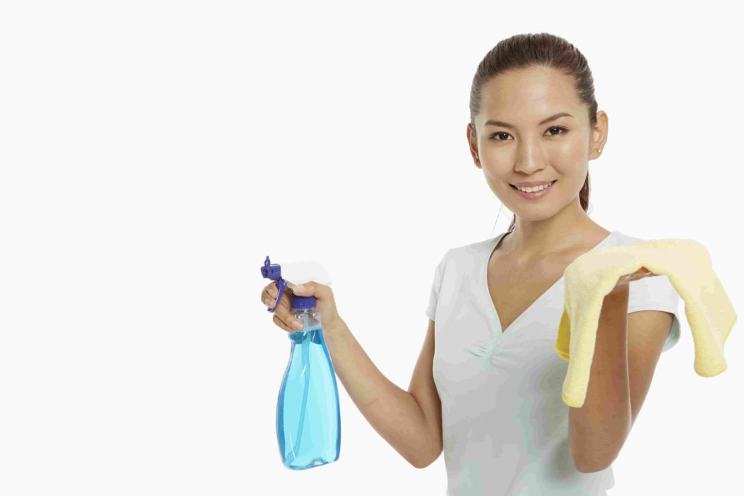 Woman with cleaning tools